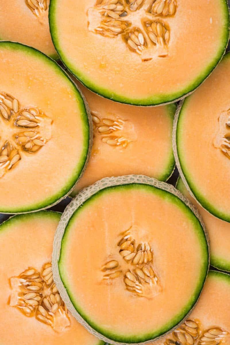 Round slices of a ripe cantaloupe melon.