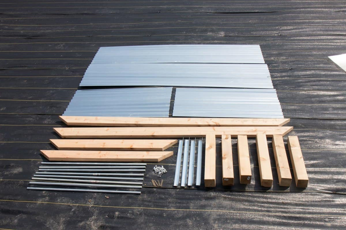 Cut list for a single galvanized steel raised garden bed - steel and cedar laid out
