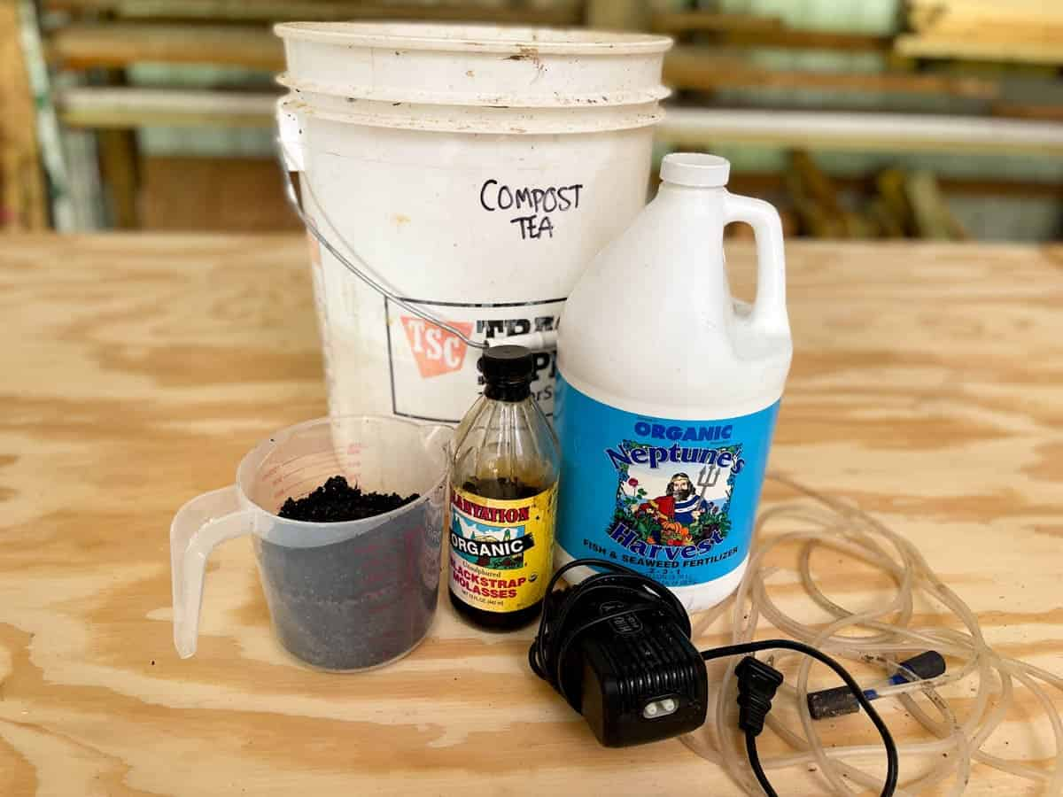 Ingredients for compost tea on a wooden surface