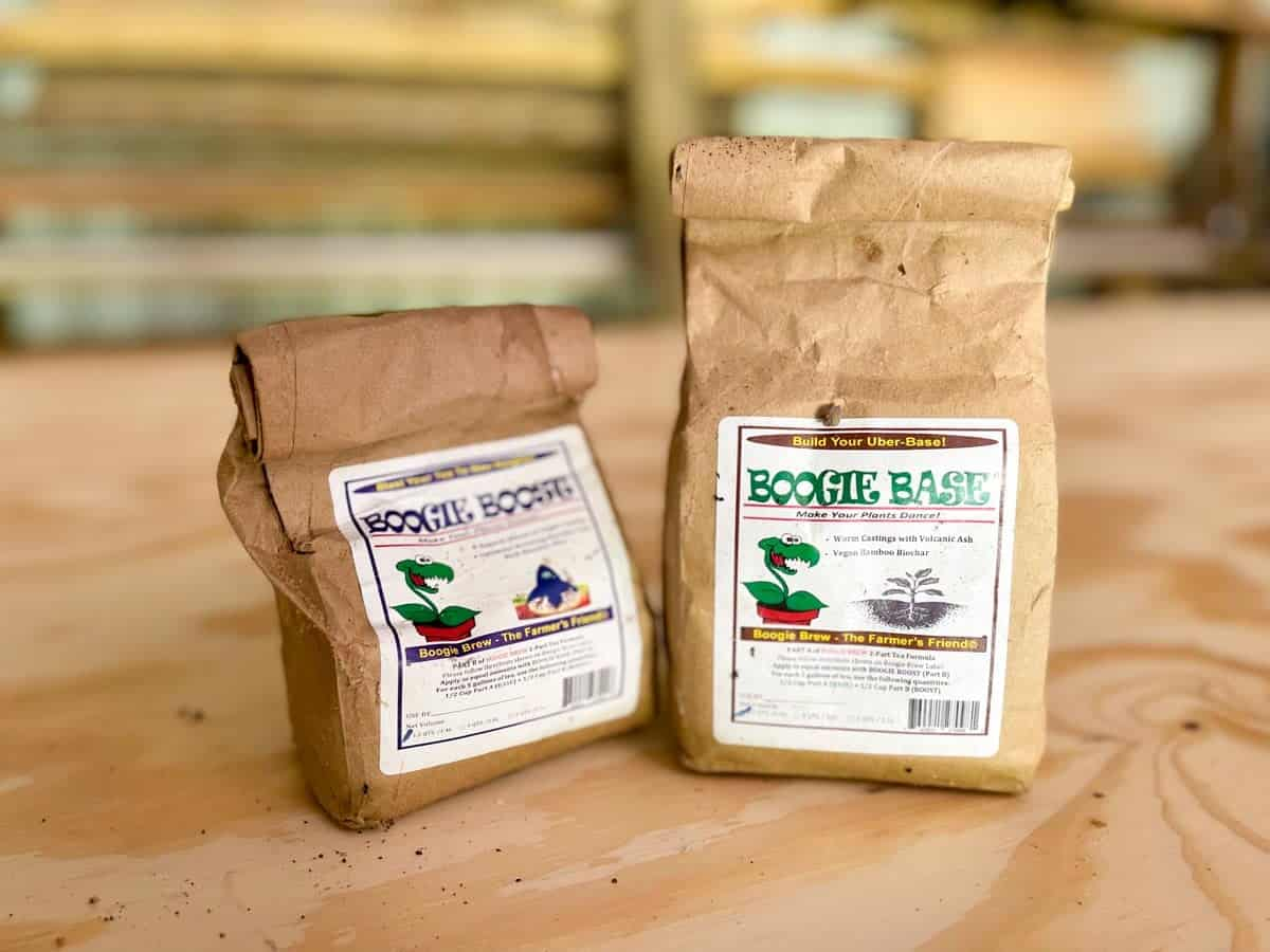 """Two bags labeled """"boogie base"""" of premade compost tea"""